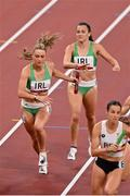 31 July 2021; Sophie Becker of Ireland takes the baton from team-mate Phil Healy during the mixed 4 x 400 metres relay final at the Olympic Stadium during the 2020 Tokyo Summer Olympic Games in Tokyo, Japan. Photo by Brendan Moran/Sportsfile
