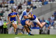 31 July 2021; Patrick Curran of Waterford in action against Padraic Maher of Tipperary during the GAA Hurling All-Ireland Senior Championship Quarter-Final match between Tipperary and Waterford at Pairc Ui Chaoimh in Cork. Photo by Daire Brennan/Sportsfile