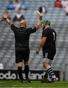 31 July 2021; Tyrone goalkeeper Conor McElhatton is shown a yellow card by referee Richie Fitzsimons during the Nickey Rackard Cup Final match between Tyrone and Mayo at Croke Park in Dublin.  Photo by Ray McManus/Sportsfile