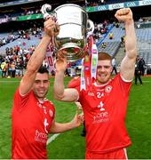 31 July 2021; Tyrone players Darren McCurry, left, and Cathal McShane celebrate with the Anglo Celt Cup after the Ulster GAA Football Senior Championship Final match between Monaghan and Tyrone at Croke Park in Dublin. Photo by Ray McManus/Sportsfile