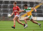 31 July 2021; Darragh Cashman of Cork in action against Fionn Dempsey of Offaly during the 2021 EirGrid GAA All-Ireland Football U20 Championship Semi-Final match between Cork and Offaly at MW Hire O'Moore Park in Portlaoise, Laois. Photo by Matt Browne/Sportsfile