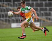 31 July 2021; Cathal Donoghue of Offaly in action against Darragh Holland of Cork during the 2021 EirGrid GAA All-Ireland Football U20 Championship Semi-Final match between Cork and Offaly at MW Hire O'Moore Park in Portlaoise, Laois. Photo by Matt Browne/Sportsfile