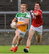 31 July 2021; Cormac Egan of Offaly in action against Conor McGoldrick of Cork during the 2021 EirGrid GAA All-Ireland Football U20 Championship Semi-Final match between Cork and Offaly at MW Hire O'Moore Park in Portlaoise, Laois. Photo by Matt Browne/Sportsfile