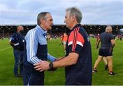 31 July 2021; Dublin manager Mattie Kenny and Cork manager Kieran Kingston shake hands after the GAA Hurling All-Ireland Senior Championship Quarter-Final match between Dublin and Cork at Semple Stadium in Thurles, Tipperary. Photo by Piaras Ó Mídheach/Sportsfile