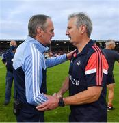 31 July 2021; Dublin manager Mattie Kenny, left, and Cork manager Kieran Kingston shake hands after the GAA Hurling All-Ireland Senior Championship Quarter-Final match between Dublin and Cork at Semple Stadium in Thurles, Tipperary. Photo by Piaras Ó Mídheach/Sportsfile