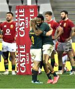 31 July 2021; Lukhanyo Am of South Africa, right, celebrates with team-mate Faf de Klerk after scoring a try during the second test of the British and Irish Lions tour match between South Africa and British and Irish Lions at Cape Town Stadium in Cape Town, South Africa. Photo by Ashley Vlotman/Sportsfile