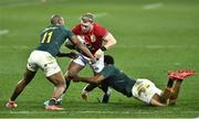 31 July 2021; Stuart Hogg of the British and Irish Lions tackled by Makazole Mapimpi and Lukhanyo Am of South Africa during the second test of the British and Irish Lions tour match between South Africa and British and Irish Lions at Cape Town Stadium in Cape Town, South Africa. Photo by Ashley Vlotman/Sportsfile