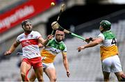 1 August 2021; Deaghlan Foley of Derry in action against Aidan Treacy, centre, and David King of Offaly during the Christy Ring Cup Final match between Derry and Offaly at Croke Park in Dublin.  Photo by Piaras Ó Mídheach/Sportsfile