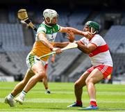 1 August 2021; Oisín Kelly of Offaly in action against Seán Cassidy of Derry during the Christy Ring Cup Final match between Derry and Offaly at Croke Park in Dublin. Photo by Ray McManus/Sportsfile