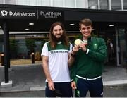 1 August 2021; Gold medallists Paul O'Donovan, left, and Fintan McCarthy at Dublin Airport as Team Ireland's rowers return from the Tokyo 2020 Olympic Games. Photo by David Fitzgerald/Sportsfile