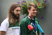 1 August 2021; Gold medallists Paul O'Donovan, left, and Fintan McCarthy are interviewed by RTE and Virgin News at Dublin Airport as Team Ireland's rowers return from the Tokyo 2020 Olympic Games. Photo by David Fitzgerald/Sportsfile