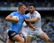 1 August 2021; Ciarán Kilkenny of Dublin is tackled by Kevin Flynn of Kildare during the Leinster GAA Football Senior Championship Final match between Dublin and Kildare at Croke Park in Dublin. Photo by Ray McManus/Sportsfile