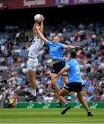 1 August 2021; Mick O'Grady of Kildare catches the ball ahead of Con O'Callaghan and James McCarthy, 5, of Dublin during the Leinster GAA Football Senior Championship Final match between Dublin and Kildare at Croke Park in Dublin. Photo by Ray McManus/Sportsfile