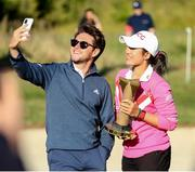 1 August 2021; Niall Horan of Modest Golf poses for a selfie with the Ladies winner Pajaree Anannarukarn of Thailand after Day Four of The ISPS HANDA World Invitational at Galgorm Spa & Golf Resort in Ballymena, Antrim. Photo by John Dickson/Sportsfile