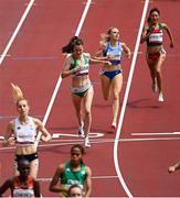 2 August 2021; Ciara Mageean of Ireland, centre, crosses the finish line during round one of the women's 1500 metres at the Olympic Stadium on day ten of the 2020 Tokyo Summer Olympic Games in Tokyo, Japan. Photo by Ramsey Cardy/Sportsfile