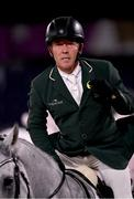 2 August 2021; Austin O'Connor of Ireland riding Colorado Blue holds a ribbon on his lapel after finishing his round in the eventing jumping individual final at the Equestrian Park during the 2020 Tokyo Summer Olympic Games in Tokyo, Japan. Photo by Brendan Moran/Sportsfile