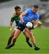 2 August 2021; Ciarán Duggan of Dublin in action against Sean Emmanuel of Meath during the 2021 Electric Ireland Leinster Minor Football Championship Final match between Meath and Dublin at Bord Na Mona O'Connor Park in Tullamore, Offaly. Photo by Ray McManus/Sportsfile