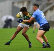 2 August 2021; Sean Emmanuel of Meath is tackled by Ciarán Duggan of Dublin during the 2021 Electric Ireland Leinster Minor Football Championship Final match between Meath and Dublin at Bord Na Mona O'Connor Park in Tullamore, Offaly. Photo by Ray McManus/Sportsfile