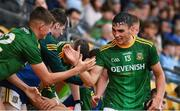 2 August 2021; Christian Finlay of Meath, 13, is congratulated by with his team mates as he arrives at the subs bench after being substituted late in the 2021 Electric Ireland Leinster Minor Football Championship Final match between Meath and Dublin at Bord Na Mona O'Connor Park in Tullamore, Offaly. Photo by Ray McManus/Sportsfile