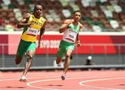 3 August 2021; Leon Reid of Ireland, right, and Julian Forte of Jamaica in action during the men's 200 metre heats at the Olympic Stadium during the 2020 Tokyo Summer Olympic Games in Tokyo, Japan. Photo by Ramsey Cardy/Sportsfile
