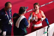 3 August 2021; Kellie Harrington of Ireland with coaches John Conlan, centre, and Zaur Antia after her victory in the women's lightweight quarter-final bout against Imane Khelif of Algeria at the Kokugikan Arena during the 2020 Tokyo Summer Olympic Games in Tokyo, Japan. Photo by Brendan Moran/Sportsfile
