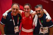 3 August 2021; Kellie Harrington of Ireland with coaches John Conlan, right, and Zaur Antia after her victory in the women's lightweight quarter-final bout against Imane Khelif of Algeria at the Kokugikan Arena during the 2020 Tokyo Summer Olympic Games in Tokyo, Japan. Photo by Brendan Moran/Sportsfile