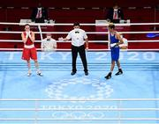 3 August 2021; Kellie Harrington of Ireland, left, is declared victorious in her women's lightweight quarter-final bout against Imane Khelif of Algeria at the Kokugikan Arena during the 2020 Tokyo Summer Olympic Games in Tokyo, Japan. Photo by Stephen McCarthy/Sportsfile