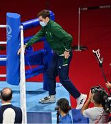 3 August 2021; Aidan Walsh of Ireland, wearing a cast, climbs into the ring before accepting his bronze medal that he won in the men's welterweight division at the Kokugikan Arena during the 2020 Tokyo Summer Olympic Games in Tokyo, Japan. Photo by Brendan Moran/Sportsfile