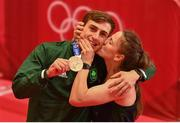 3 August 2021; Michaela Walsh of Ireland kisses her brother Aidan Walsh of Ireland with his bronze medal that he won in the men's welterweight division at the Kokugikan Arena during the 2020 Tokyo Summer Olympic Games in Tokyo, Japan. Photo by Brendan Moran/Sportsfile