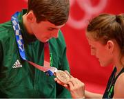 3 August 2021; Michaela Walsh of Ireland admires the bronze medal of her brother Aidan Walsh after the men's welterweight division medal ceremony at the Kokugikan Arena during the 2020 Tokyo Summer Olympic Games in Tokyo, Japan. Photo by Brendan Moran/Sportsfile