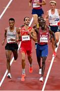 3 August 2021; Mohamed Katir of Spain, centre, on his way to winning the men's 5000m, alongside second place Paul Chelimo of the United States, right, and third place, Justyn Knight of Canada, left, at the Olympic Stadium during the 2020 Tokyo Summer Olympic Games in Tokyo, Japan. Photo by Ramsey Cardy/Sportsfile