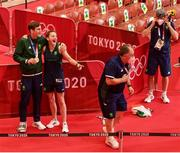 3 August 2021; Coach Zaur Antia dances as bronze medalist Aidan Walsh of Ireland and his sister Michaela Walsh poses for a photograph after the men's welterweight division medal ceremony at the Kokugikan Arena during the 2020 Tokyo Summer Olympic Games in Tokyo, Japan. Photo by Brendan Moran/Sportsfile