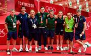 3 August 2021; Bronze medalists Aidan Walsh of Ireland with backroom team, from left, Dr Jim Clover, physiotherapist Lorcan McGee, coach Zaur Antia, high performance director Bernard Dunne, Michaela Walsh, coach Dmitry Dmitruk and sports performance coach Kevin McManamon after the victory ceremony at the Kokugikan Arena during the 2020 Tokyo Summer Olympic Games in Tokyo, Japan.  Photo by Brendan Moran/Sportsfile