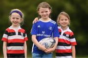 3 August 2021; Carly Quigley, centre, age 8, with Cara Butler, left, age 7, and Sadie Devereux, age 7, during the Bank of Ireland Leinster Rugby Summer Camp at Enniscorthy RFC in Enniscorthy, Wexford. Photo by Matt Browne/Sportsfile