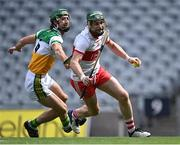 1 August 2021; Gerald Bradley of Derry in action against Ben Conneely of Offaly during the Christy Ring Cup Final match between Derry and Offaly at Croke Park in Dublin.  Photo by Piaras Ó Mídheach/Sportsfile