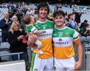 1 August 2021; Offaly captain Ben Conneely with his daughter Liadán, 8 months, and team-mate Luke O'Connor after the Christy Ring Cup Final match between Derry and Offaly at Croke Park in Dublin. Photo by Piaras Ó Mídheach/Sportsfile