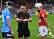 31 July 2021; Referee James Owens performs the coin toss with team captains Danny Sutcliffe of Dublin and Patrick Horgan of Cork before the GAA Hurling All-Ireland Senior Championship Quarter-Final match between Dublin and Cork at Semple Stadium in Thurles, Tipperary. Photo by Piaras Ó Mídheach/Sportsfile