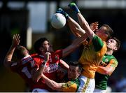 25 July 2021; Kerry goalkeeper Shane Ryan punches the ball clear, supported by team-mates Paul Murphy, left, and David Moran, and ahead of Cork players Brian Hurley, far left, and Ian Maguire during the Munster GAA Football Senior Championship Final match between Kerry and Cork at Fitzgerald Stadium in Killarney, Kerry. Photo by Piaras Ó Mídheach/Sportsfile