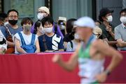 5 August 2021; Spectators watch as David Kenny of Ireland competes in the men's 20 kilometre walk final at Sapporo Odori Park on day 13 during the 2020 Tokyo Summer Olympic Games in Sapporo, Japan. Photo by Ramsey Cardy/Sportsfile