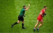 31 July 2021; Referee David Gough shows a yellow card to Niall Kelly of Tyrone during the Ulster GAA Football Senior Championship Final match between Monaghan and Tyrone at Croke Park in Dublin. Photo by Sam Barnes/Sportsfile