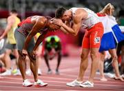 5 August 2021; Damian Warner of Canada is congratulated by Pawel Wiesiolek of Poland after winning the gold meldal in the Men's Decathlon during the 1500 metres of the men's decathlon at the Olympic Stadium on day 13 during the 2020 Tokyo Summer Olympic Games in Tokyo, Japan. Photo by Stephen McCarthy/Sportsfile