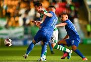 5 August 2021; Ronan Finn of Shamrock Rovers in action against Blerim Kotobelli, centre, and Jackson of Teuta during the UEFA Europa Conference League third qualifying round first leg match between Shamrock Rovers and Teuta at Tallaght Stadium in Dublin. Photo by Eóin Noonan/Sportsfile