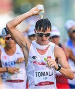 6 August 2021; Dawid Tomala of Poland cools himself with water during the men's 50 kilometre walk final at Sapporo Odori Park on day 14 during the 2020 Tokyo Summer Olympic Games in Sapporo, Japan. Photo by Ramsey Cardy/Sportsfile