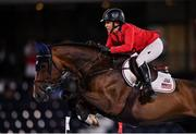6 August 2021; Laura Kraut of the United States riding Baloutinue during the jumping team qualifier at the Equestrian Park during the 2020 Tokyo Summer Olympic Games in Tokyo, Japan. Photo by Brendan Moran/Sportsfile