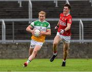 31 July 2021; Cormac Egan of Offaly in action against Conor McGoldrick of Cork during the 2021 EirGrid GAA All-Ireland Football U20 Championship Semi-Final match between Cork v Offaly at MW Hire O'Moore Park in Portlaoise, Laois. Photo by Matt Browne/Sportsfile