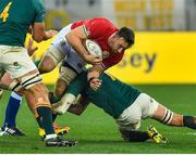 7 August 2021; Jack Conan of British and Irish Lions is tackled by Steven Kitshoff of South Africa during the third test of the British and Irish Lions tour match between South Africa and British and Irish Lions at Cape Town Stadium in Cape Town, South Africa. Photo by Ashley Vlotman/Sportsfile