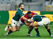 7 August 2021; Bundee Aki of the British & Irish Lions is tackled by Cobus Reinach, left, and Handré Pollard of South Africa during the third test of the British and Irish Lions tour match between South Africa and British and Irish Lions at Cape Town Stadium in Cape Town, South Africa. Photo by Ashley Vlotman/Sportsfile