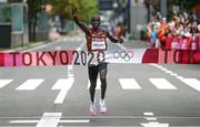 8 August 2021; Eliud Kipchoge of Kenya celebrates as he crosses the finish line to win the men's marathon at Sapporo Odori Park on day 16 during the 2020 Tokyo Summer Olympic Games in Sapporo, Japan. Photo by Ramsey Cardy/Sportsfile