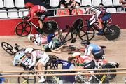 8 August 2021; Emily Kay of Ireland crashes during the women's omnium scratch race at Izu velodrome on day 16 during the 2020 Tokyo Summer Olympic Games in Shizuoka, Japan. Photo by Alex Broadway/Sportsfile