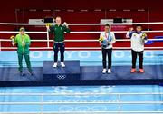 8 August 2021; Silver medalist Beatriz Ferreira of Brazil, left, gold medalist Kellie Harrington of Ireland, centre, and bronze medalists Mira Marjut Johanna Potkonen of Finland and Sudaporn Seesondee of Thailand with their medals after the women's lightweight bouts at the Kokugikan Arena during the 2020 Tokyo Summer Olympic Games in Tokyo, Japan. Photo by Brendan Moran/Sportsfile